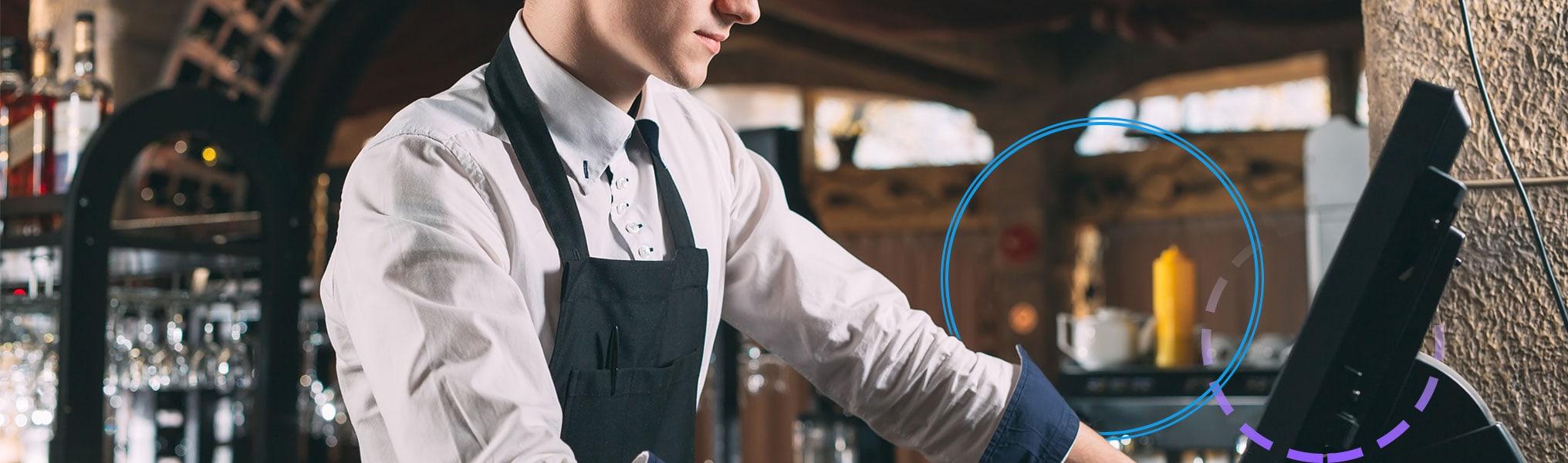 Waiter placing order on POS terminal