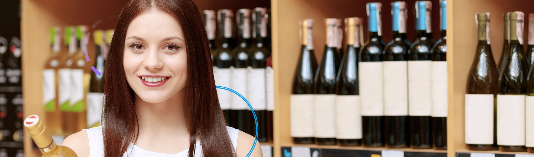 Woman at wine store with wine bottles in background