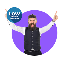 Guy with vest point up with both hands and LOW Monthly Financing offer