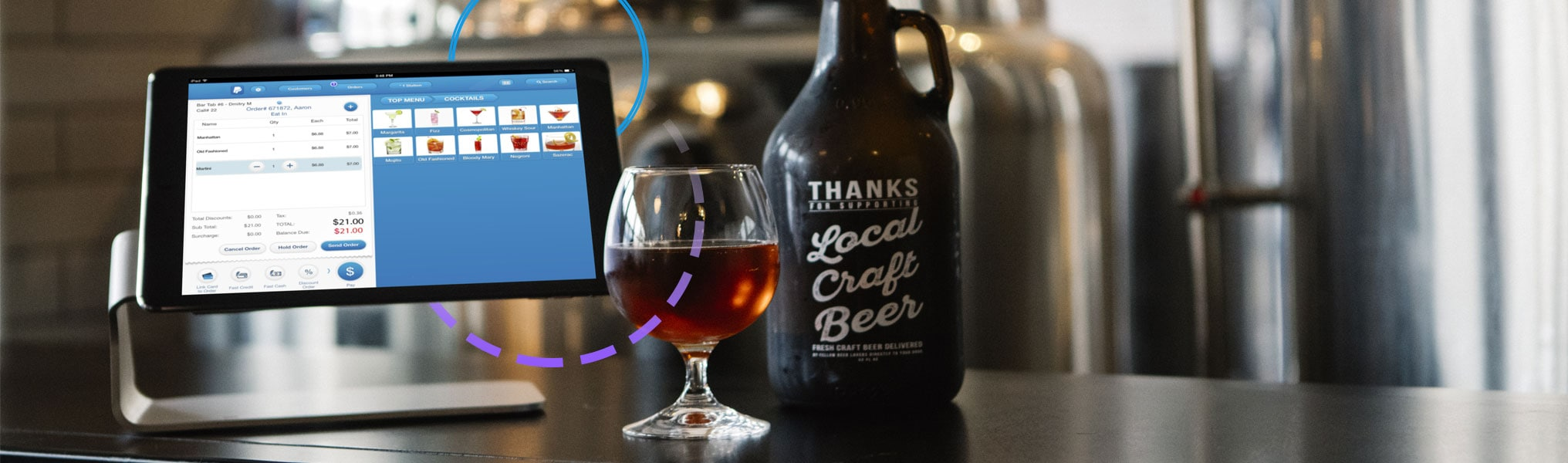 Revel Systems iPad on C-Stand in craft beer establishment with growler and snifter of beer