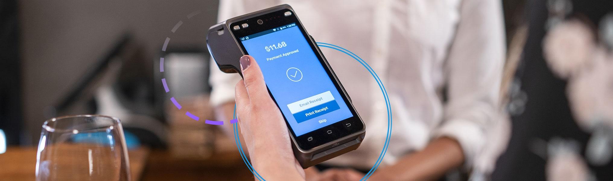 SkyTab handheld terminal taking payment