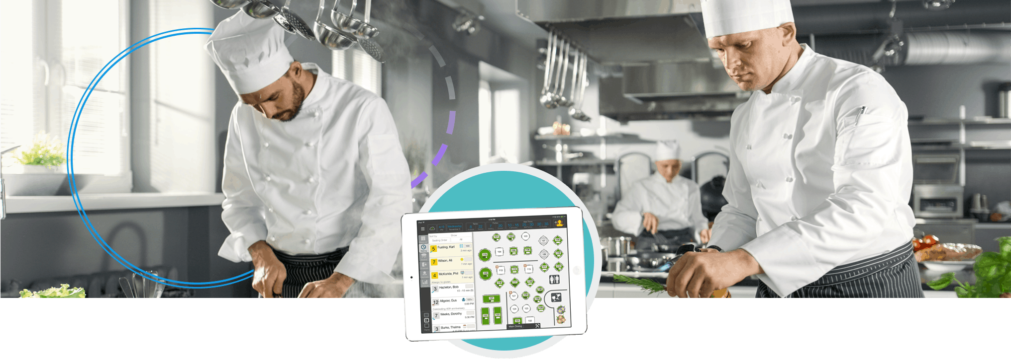Two chefs cooking with table management iPad